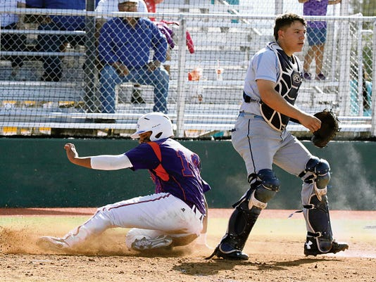 Rudy Gutierrez—El Paso Times Eastlake's Alex Pinedo, 14, slides safely into home plate as Chapin catcher Kevin Whitaker waits for the throw Thursday at the El Paso Community College baseball field. The Falcons defeated the Hustkies 8-2.