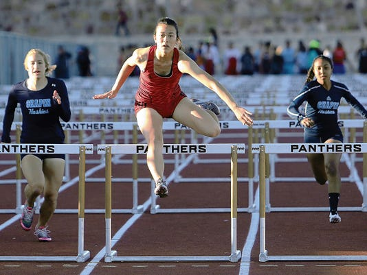 Rudy Gutierrez—El Paso Times Priscilla Tubbs, center, of Jefferson clears the last hurdle on her way to first place in the varsity girl's 100 meter hurdles event Friday at the District 1-5A track meet at Austin High School.