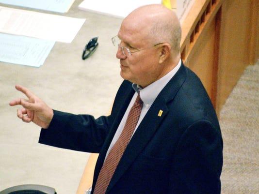 Senate Majority Leader Michael Sanchez, D-Belen, talks to a fellow senator on the Senate floor Monday in Santa Fe.