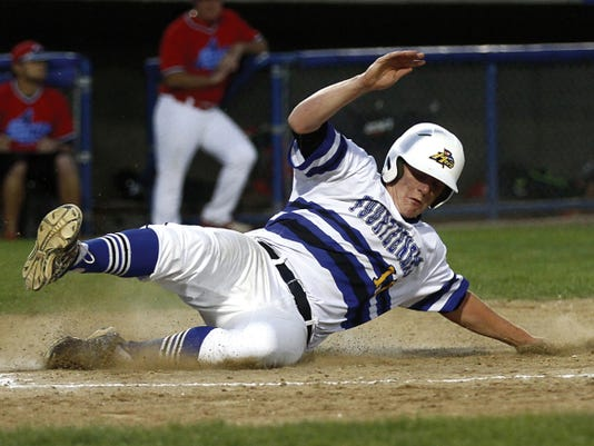 The 14ers' Noah Loutherback slides home safely against the 4-Corners Club Sox Saturday in the championship game of the Connie Mack City Tournament at Ricketts Park in Farmington.