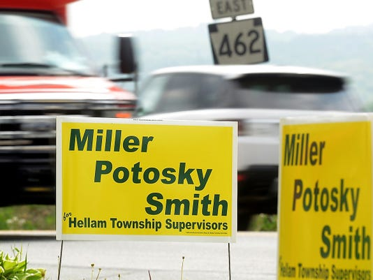 Campaign signs for Hellam Township supervisor candidates are posted along Route 462 east of Hallam Borough this week. Four similar signs were reported stolen May 7.
