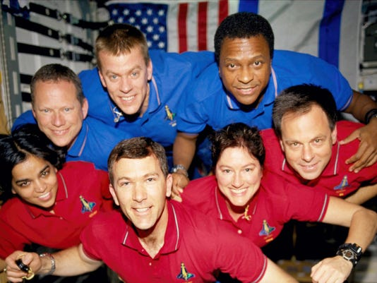 The seven crew members pose aboard the Space Shuttle Columbia. This picture was on a roll of unprocessed film later recovered by searchers from the debris. From the left, bottom row, are mission specialist Kalpana Chawla, commander, Rick D. Husband, mission commander Laurel B. Clark and Ilan Ramon, payload specialist; and top row, mission specialist David M. Brown, pilot William C. McCool, pilot; and payload commander Michael P. Anderson.