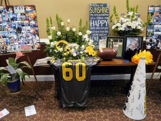 Photographs, flowers and other memorabilia fill a display table during Nick Mankin's funeral in June at Olewiler and Heffner Funeral Home in York Township. Mankin and Red Lion teammate Stone Hill died in a vehicle crash. Mankin was supposed to return at right guard for the Lions football team.