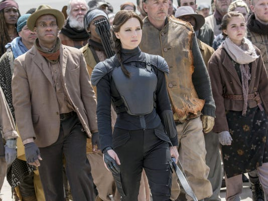"Jennifer Lawrence is Katniss Everdeen, center, in ""The Hunger Games: Mockingjay Part 2."" The movie has preview shows Wednesday at Regal West Manchester Stadium 13, Frank Theatres Queensgate Stadium 13 and R/C Hanover Movies. Regular showings begin Thursday."
