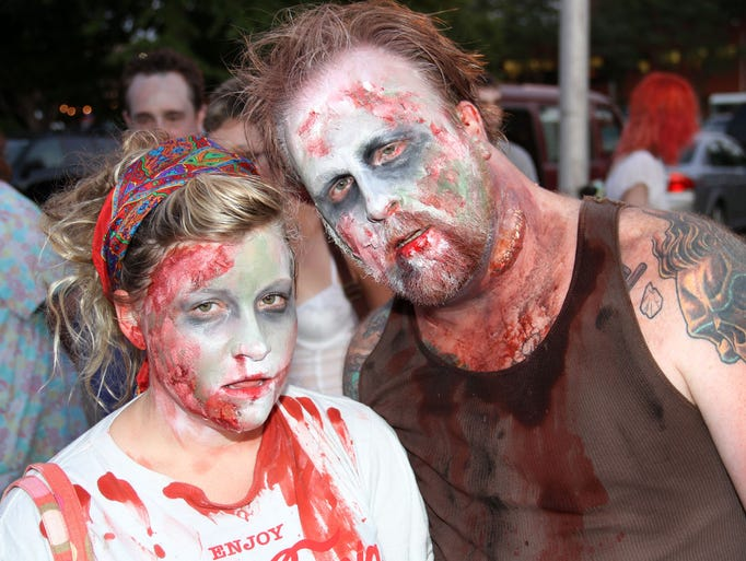Alisha Reicks and Darin Sturgill dress as zombies.