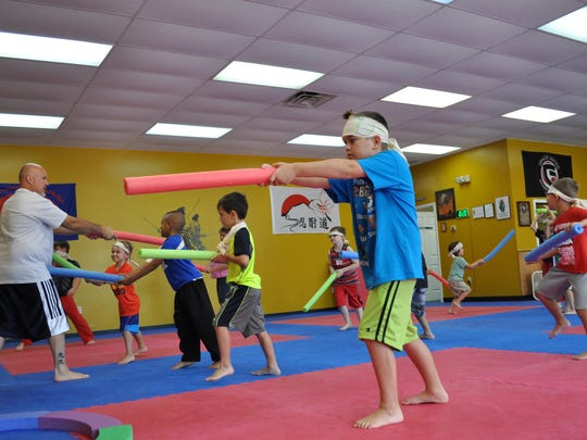 """Owner of Karate Kicks in Alexandria Clint Duplechian teaches """"Legos and Lightsabers"""" summer campers some martial arts techniques."""