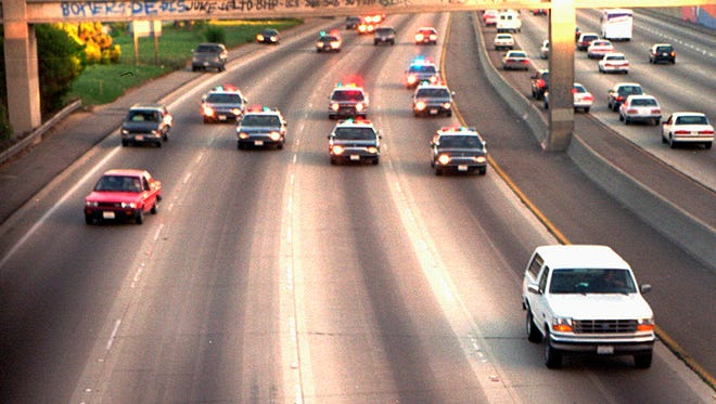This white Ford Bronco, driven by Al Cowlings carrying O.J. Simpson, is trailed by Los Angeles police cars as it travels on a Southern California freeway in Los Angeles, June 17, 1994.