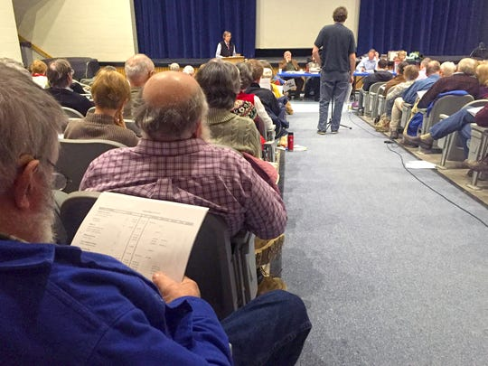 Jericho residents look over town budgets on Town Meeting Day, held at the Mount Mansfield Union High School auditorium Tuesday morning, March 1.