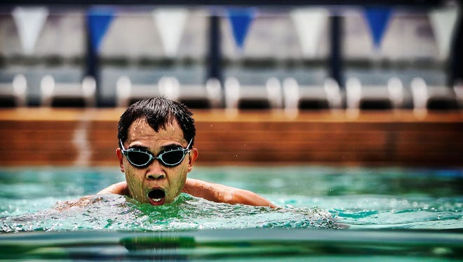 University of Memphis School of Public Health Professor Yong Yang swims laps at the Student Recreation and Fitness Center pool.