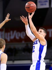 Reed Timmer of Drake takes a shot against Illinois