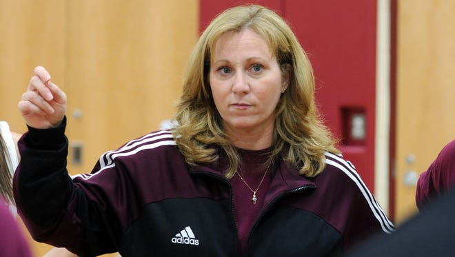 Arlington High School volleyball head coach Maria Greenwood conducts practice at the school in LaGrange on Wednesday, Nov. 17, 2010.