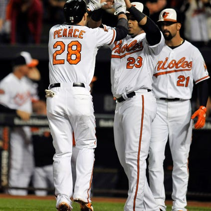 Sep 16, 2014; Baltimore, MD, USA; Baltimore Orioles first baseman Steve Pearce (28) is congratulated by Nelson Cruz (23) after hitting a three-run home run in the first inning against the Toronto Blue Jays at Oriole Park at Camden Yards. Mandatory Credit: Joy R. Absalon-USA TODAY Sports