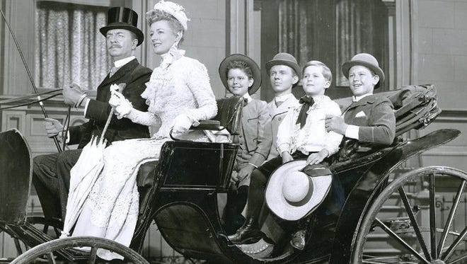 William Powell and Irene Dunne with Jimmy Lydon (third from the right) in a scene from 'Life with Father'.