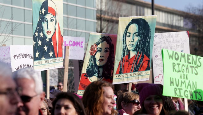 Many signs on display and being carried during the march that attracted over 3,000 people made up of women, men of different races and religions marched on the campus of Wayne State University in Detroit, Michigan on Saturday, January 21, 2017.It was one of many marches going on to coincide with the big women's march being held in Washington D.C. to send a message to the new president Donald Trump.The marchers carried a variety of signs ranging for equal treatment and equal pay to hands off women's rights.
