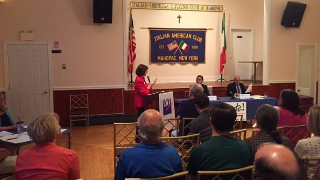 Moderator Kathering Dering, left, reads the rules to Putnam County DA candidates Adam Levy, center, and Robert Tendy, right, at a candidates' forum Tuesday, Sept. 1, 2015.