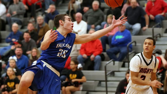 Cedar Crest's Tate Seyfert (20) reaches for a rebound against Hempfield during second-half action in a Lancaster-Lebanon boys' basketball game at Hempfield High School Thursday January 21.