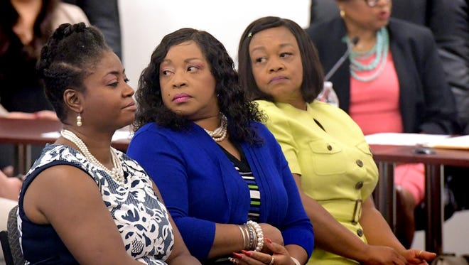 From left, Sandra Thompson, Carolyn Dow and Sandra Harrison listen as Myneca Ojo, right, give testimony during the second Pennsylvania Human Relations Commission hearing at York City Council Chambers Friday, June 22, 2018. The hearing was in response to allegations that the four and another member of the Sisters in the Fairway were racially harassed during an incident at Grandview Golf Club in April. Bill Kalina photo
