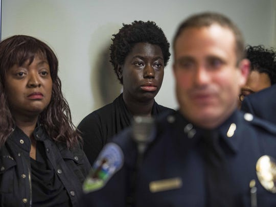 Mary Brown-Guillory, president of the Champlain Area NAACP, left, and Jocellyn Harvey, center, listen as Burlington Police Chief Brandon del Pozo speaks during a news conference in Burlington on Thursday.