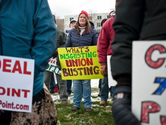 Striking FairPoint worker Cindy Allen of Milton participates in a rally at the Statehouse in Montpelier on Thursday.