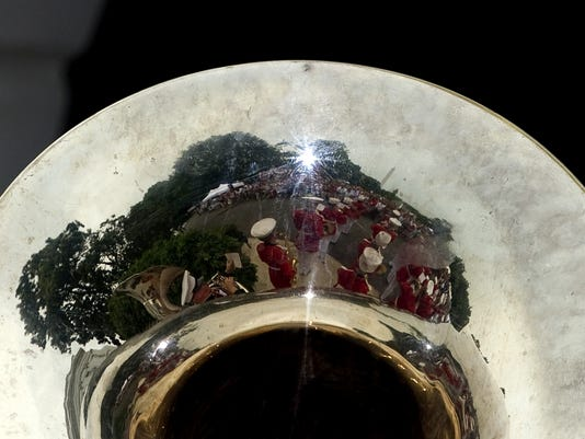 The US Marine Corps Band is reflected in