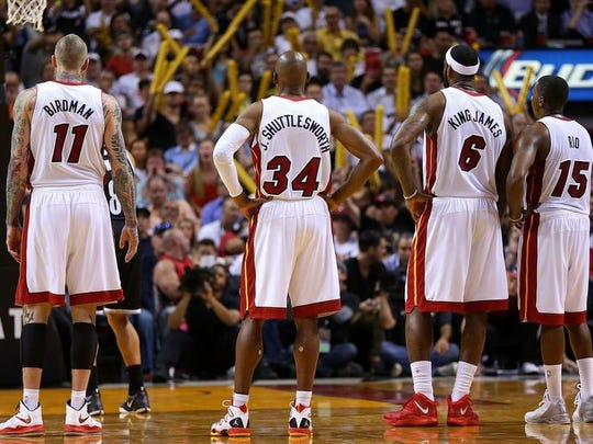 Chris Andersen #11, Ray Allen #34, LeBron James #6, and Mario Chalmers #15 of the Miami Heat look on during a game against the Brooklyn Nets.