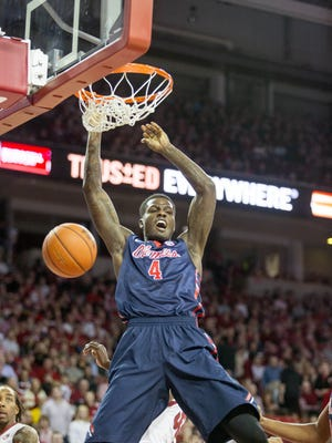 Mississippi forward M.J. Rhett, center, yells after dunking the ball during the first half of an NCAA college basketball game against Arkansas on Saturday, Jan. 17, 2015, in Fayetteville, Ark. (AP Photo/Gareth Patterson)