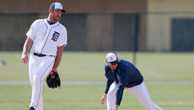 Detroit Tigers pitcher Justin Verlander, left, angles out of the way as fellow pitcher Anibal Sanchez fields grounders during Feb. 21, 2015, in Lakeland, Fla.