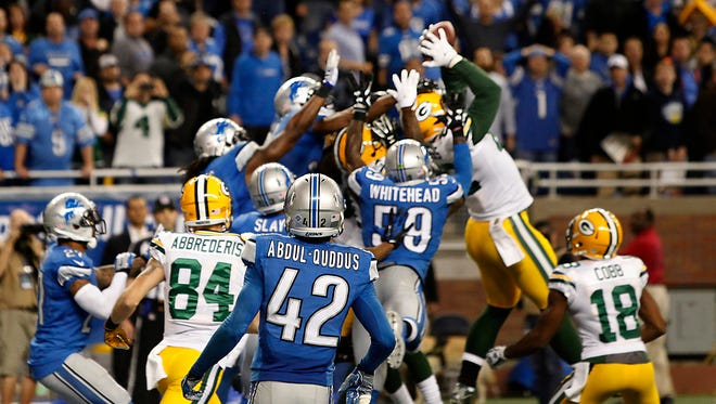 Packers tight end Richard Rodgers reaches up for the ball for a touchdown on a Hail Mary pass on a free play after a penalty to beat the Lions last season at Ford Field.