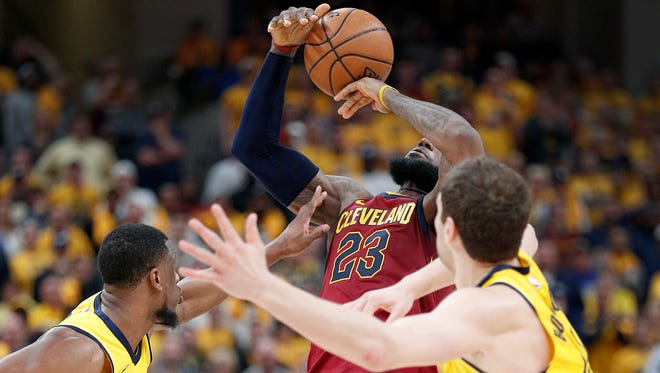 Indiana Pacers forward Thaddeus Young (21) knocks the ball away from Cleveland Cavaliers forward LeBron James (23) in the second half of game #3 of their NBA Eastern Conference playoff game on Friday April 20, 2018. The Indiana Pacers defeated the Cleveland Cavaliers 92-90.