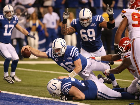 Colts quarterback Andrew Luck scores in the fourth
