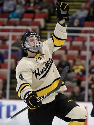Michigan Tech defenseman Dane Birks (4) reacts after his goal during the first period of a Great Lakes Invitational college hockey game against Michigan, Thursday, Dec. 29, 2016, in Detroit.
