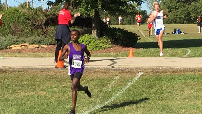 Topeka West sophomore Lenny Njoroge (1090) and Washburn Rural's Arrik White set the mid-race pace in Saturday's Seaman Invitational boys cross country race. Njoroge won in a time of 16:37 while White was third to lead the Junior Blues to the team title.