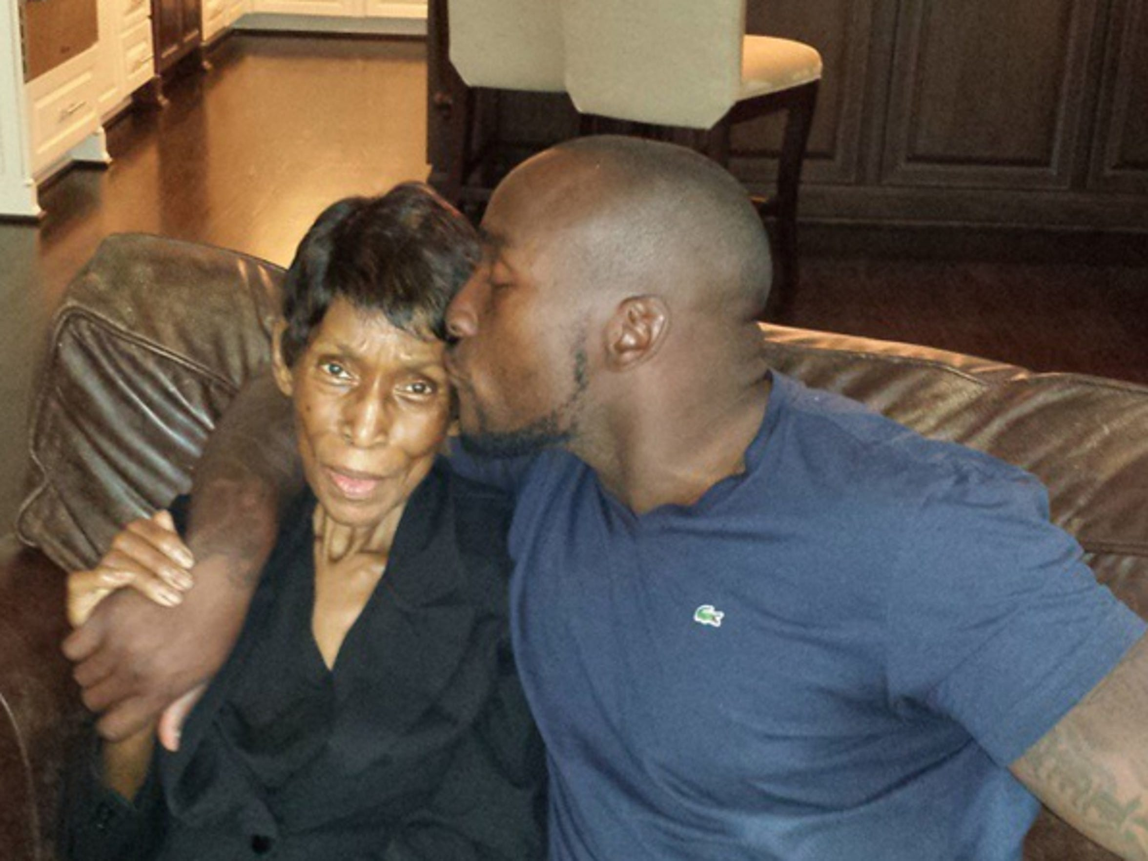 Colts linebacker Robert Mathis with his champion, mother Emma, near the end of her life.