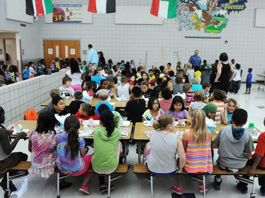 Students at Terry Redlin Elementary School eat lunch in 2014.