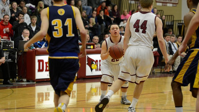 De Pere High School boy's basketball team manager Nate Wagner, who had down syndrome, takes a shot his first game as a player against Sheboygan North during Friday night's game at De Pere High School. Evan Siegle/Press-Gazette Media