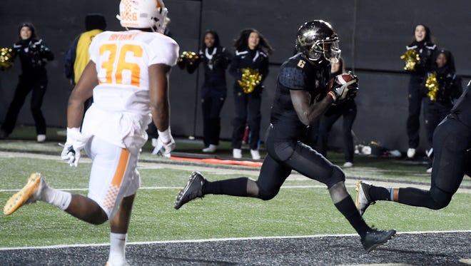 Vanderbilt wide receiver Darrius Sims (6) goes in for a fourth-quarter touchdown in the game between Vanderbilt and Tennessee at Vanderbilt Stadium Saturday, Nov. 26, 2016, in Nashville, Tenn.