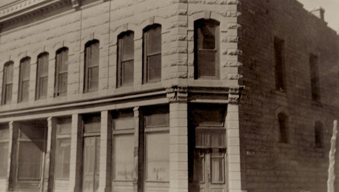 """""""Cha-ching"""" sounds were heard up and down the busy main street of prosperous White Oaks as cash registers conducted daily business. The back of the photo, taken after the building was abandoned, has this information: """"Exchange Bank. Hewitt Block."""""""