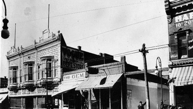 In this photo taken before 1910, at the extreme right is the Happy Hour Theater. The building at left is Vogue Dry Goods Co. on the west side of El Paso Street at San Antonio Avenue. The Gem Saloon is at center.