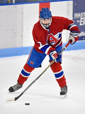 Tanner Breidenbach skates with the puck during the Saturday, Dec. 19 game against Cathedral at the MAC in St. Cloud.