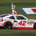 FONTANA, CA - MARCH 22:  Kyle Larson, driver of the #42 Cartwheel Chevrolet, celebrates after winning the NASCAR Nationwide Series TREATMYCLOT.COM 300 at Auto Club Speedway on March 22, 2014 in Fontana, California.  (Photo by Robert Laberge/Getty Images)