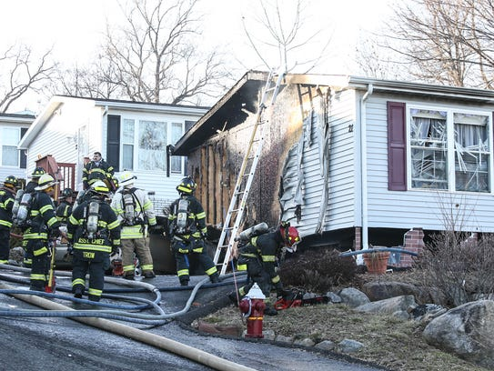 Stony Point firefighters work at a fire at 21 Thamsen