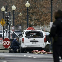 White House ends lockdown after arrest of woman who drove car into security barrier
