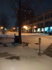 The snowy scene outside the Citizen-Times in downtown