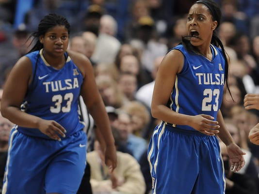 Tulsa's Ashley Clark, right, reacts toward an official after she was called for a foul as teammate Crystal Polk, left, looks on, in the first half of an NCAA college basketball game, Wednesday, Jan. 6, 2016, in Hartford, Conn. (AP Photo/Jessica Hill)