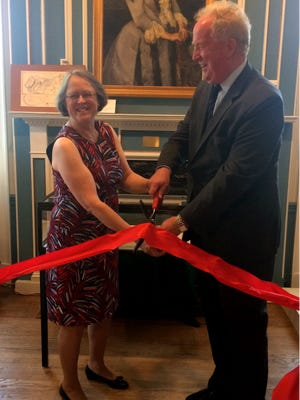 Evelyn C. Murphy, director of the Monmouth County Historical Association (left) and Freehold Mayor Nolan Higgins cut the ribbon on Monday officially opening the Hartshorne Family Papers Collection.