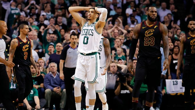 Boston Celtics forward Jayson Tatum (0) reacts after a foul during the fourth quarter against the Cleveland Cavaliers in game seven of the Eastern conference finals of the 2018 NBA Playoffs at TD Garden.