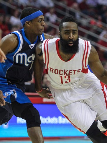 Houston Rockets guard James Harden (13) drives to the