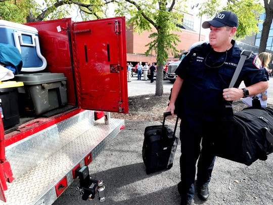 Jim White, with the Murfreesboro Fire Department loads up gear behind the old Murfreesboro Police station to deploy to South Caroline to help with Hurricane Florence relief,  on Wednesday, Sept. 12, 2018.  Members from the Murfreesboro, Rutherford County and Lebanon Fire Departments were deployed.