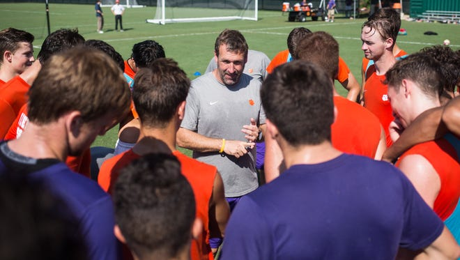 Clemson head coach Mike Noonan speaks to the team at the end of practice on August 25, 2016.