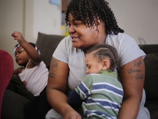 Pamela Battle, 36, of Flint,  says her entire household